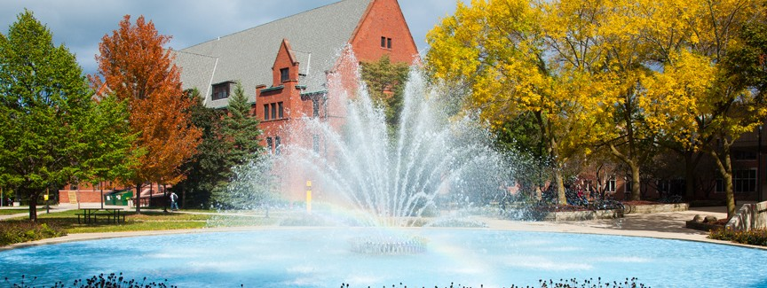 Campus scene: The Curtin Fountain with a rainbow in the water